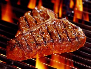 A tasty steak cooking on the grill